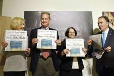 """From left, Friends of Greenwich Library Chair Sharon Fortenbaugh, Greenwich Library Board of Trustees President Chip Haslun, Greenwich Library Director Barbara Ormerod-Glynn, and Greenwich First Selectman Peter Tesei unveil the 2017 Greenwich Reads Together book """"News of the World"""" at Greenwich Library in Greenwich, Conn. Tuesday, May 23, 2017. The 2016 novel """"News of the World,"""" by Paulette Jiles, was chosen as the book for the community-wide reading experience. The middle school companion book chosen was """"The Ransom of Mercy Carter,"""" by Caroline B. Cooney, and the elementary school companion chosen was """"The Girl Who Loved Wild Horses,"""" by Paul Goble."""