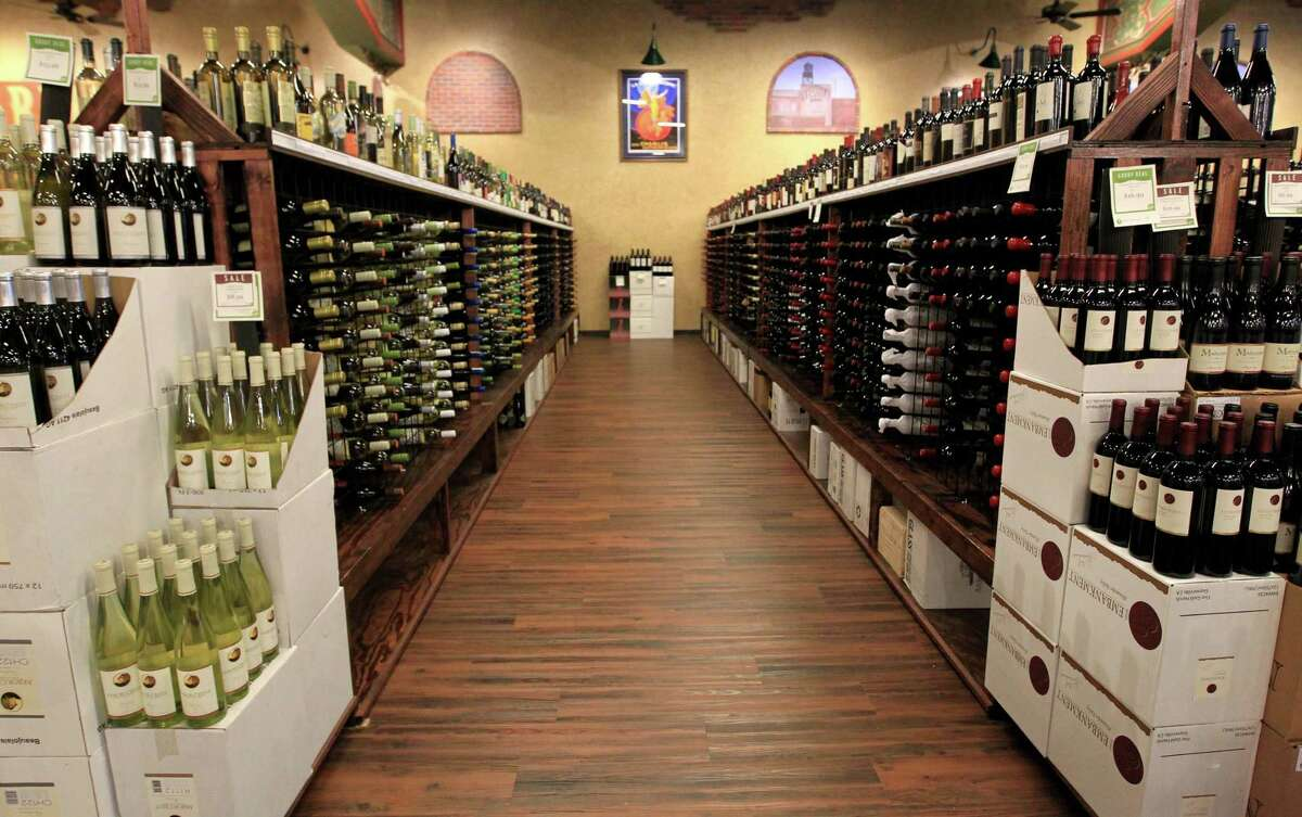One of the wine aisles at Goody Goody, Wednesday, July 10, 2013, in Humble. The store's last day as Goody Goody is June 3, and it will reopen as Total Wine on or around June 8. Click through the following photos for a look inside a Total Wine store.