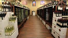 One of the wine aisles at Goody Goody, Wednesday, July 10, 2013, in Humble. The store's last day as Goody Goody is June 3, and it will reopen as Total Wine on or around June 8. ( Karen Warren / Houston Chronicle )