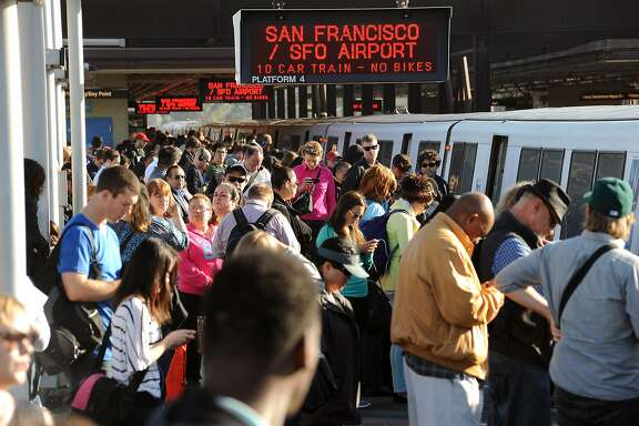 Crowds of commuters wait to board San Francisco bound trains at the MacArthur BART station in Oakland, CA on Friday May 31st, 2013. BART is experiencing severe delays while trains are running single track after two maintenance vehicles collided in the transbay tube, resulting in track damage needing repair.