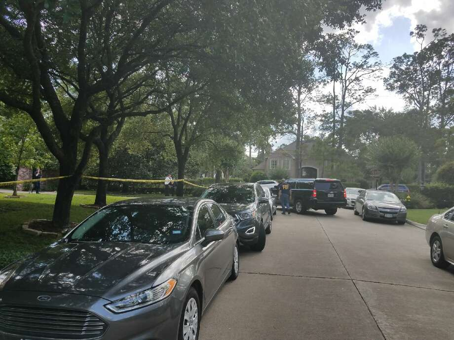 The FBI and other federal authorities raided a ritzy Hedwig Village home Tuesday. Photo: Brooke A. Lewis