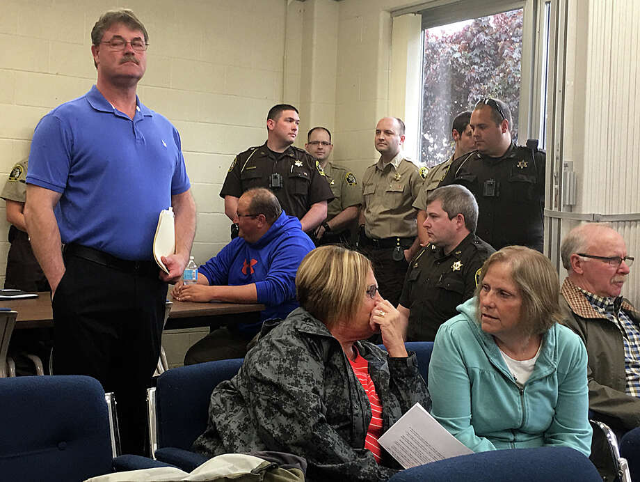 Huron County Sheriff Kelly J. Hanson and several uniformed deputies are pictured in the gallery at Tuesday's board of commissioners meeting. Photo: Brenda Battel/Huron Daily Tribune