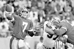 Quarterback Rick Neuheisel throws a pass for the San Antonio Gunslingers of the United States Football League, circa 1985, at Alamo Stadium.
