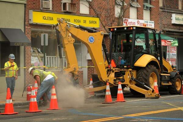Work continues on the Eversource gas line installation on Main Street in Ansonia, Conn. on Tuesday, July 5, 2016.