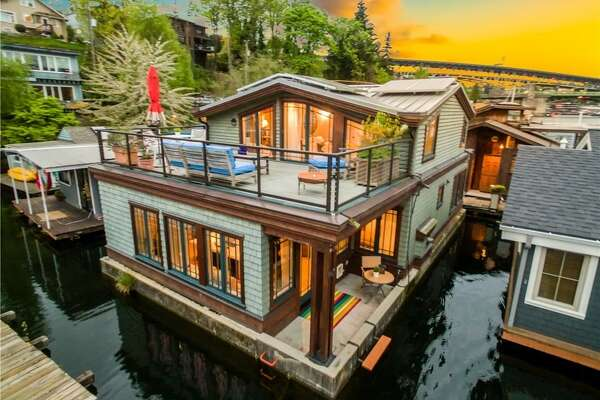 A classic Seattle floating home that makes Portage Bay your yard. On top of that access, this 3-bedroom has tons of high-end finishes like exposed fir beams, a gas fireplace and solar power.   3146 Portage Bay Pl. E. #N, listed for $1,350,000. See the  full listing here .