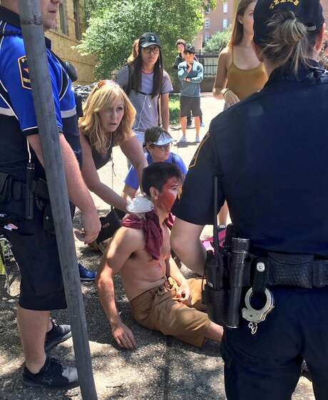 A person is treated by first responders after a deadly stabbing attack on University of Texas campus in Austin, Texas, Monday, May 1, 2017. (Emily Johnson via AP) Photo: Emily Johnson, UGC / Emily Johnson
