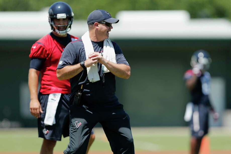 Houston Texans head coach Bill O'Brien demonstrates how to drop back to quarterback Tom Savage (3) during the Houston Texans OTAs at the Methodist Training Center in Houston, TX on Tuesday, May 23, 2017. Photo: Tim Warner, Freelance / Houston Chronicle