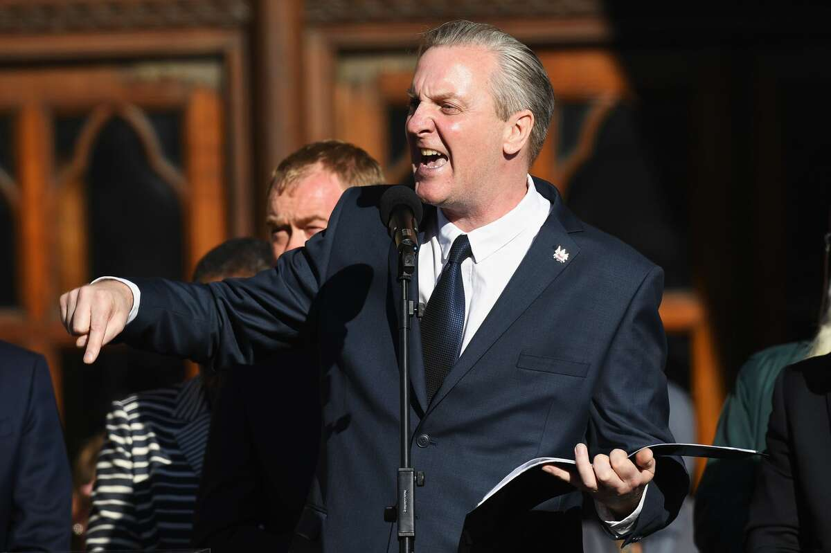 Poet Tony Walsh speaks as members of the public gather at a vigil, to honour the victims of Monday evening's terror attack, at Albert Square on May 23, 2017 in Manchester, England. Monday's explosion occurred at Manchester Arena as concert goers were leaving the venue after Ariana Grande had just finished performing. Greater Manchester Police are treating the explosion as a terrorist attack and have confirmed 22 fatalities and 59 injured. (Photo by Leon Neal/Getty Images)