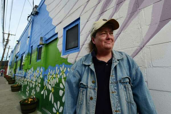 A client of The Open Door Shelter, Kathy Word, waits outside of the shelter's Merritt Street location in Norwalk, Wednesday, May 11, 2016.