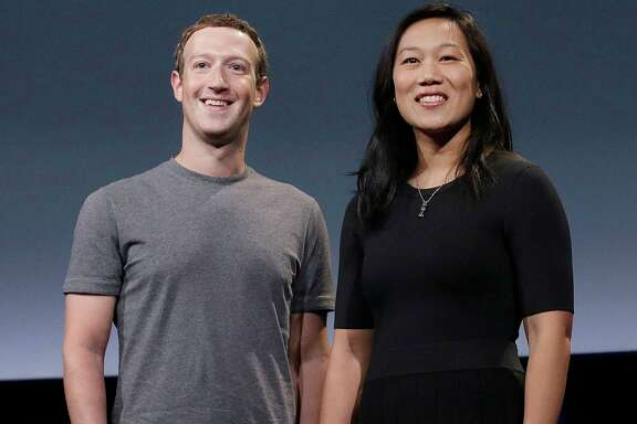 FILE- In this Sept. 20, 2016, file photo, Facebook CEO Mark Zuckerberg and his wife, Priscilla Chan, smile as they prepare for a speech in San Francisco. The 33-year-old billionaire and his wife stopped by Quincy High School on Tuesday, May 23, 2017, and made a donation to the school. Chan graduated from Quincy High as valedictorian in 2003.