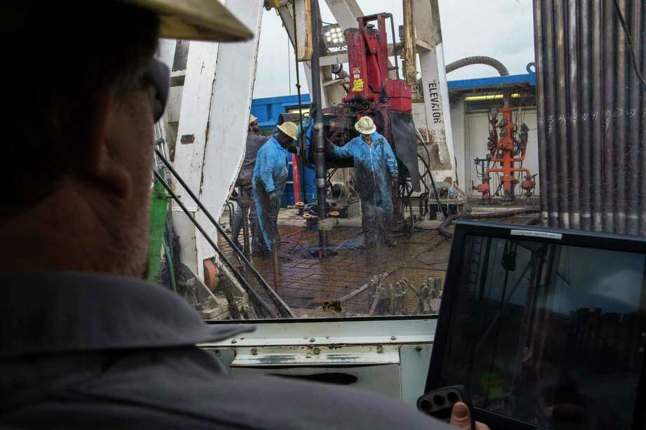 A driller controls the drilling process from the cabin through the control joy sticks and screens. The driller uses strategically mounted cameras on the rig to monitor activities, Tuesday, May 9, 2017, near College Station. Photo: Marie D. De Jesus, Houston Chronicle / © 2017 Houston Chronicle