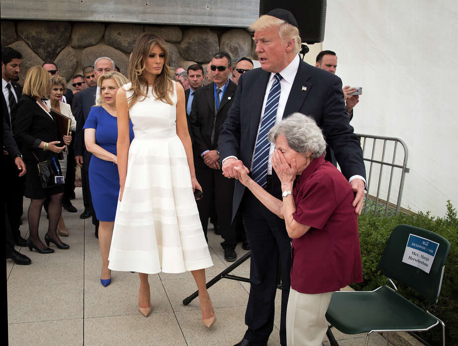 President Donald Trump, center, and first lady Melania, left, meet with Margot Herschenbaum, a Holocaust survivor, during a visit to Yad Vashem, the official Holocaust memorial in Jerusalem. Photo: STEPHEN CROWLEY, STF / NYTNS