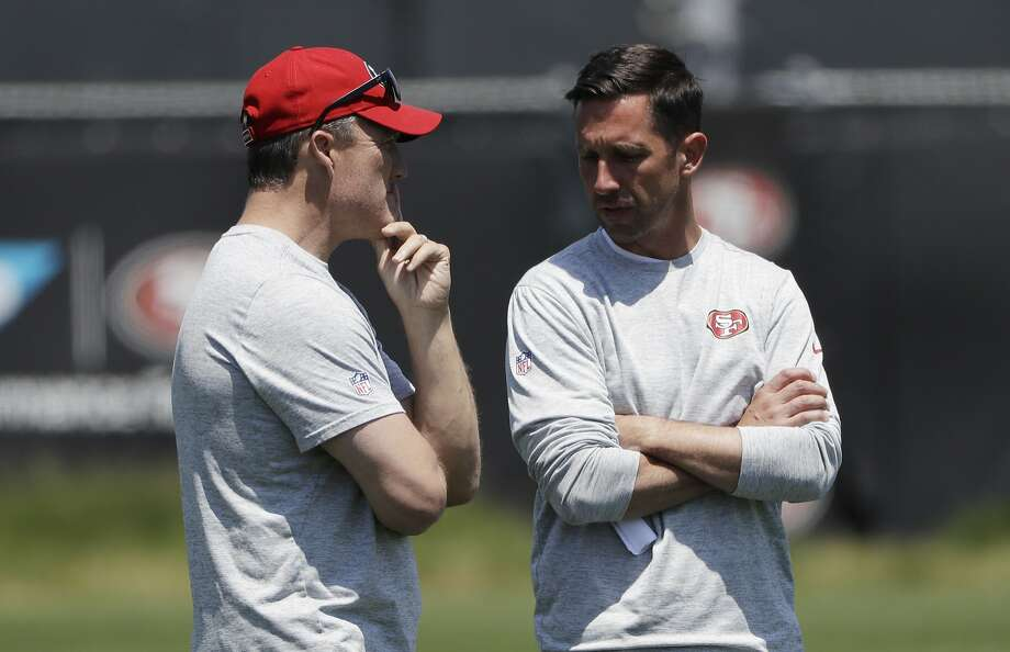 San Francisco 49ers head coach Kyle Shanahan (right) talks to general manager John Lynch at the team's NFL training facility, on May 23, 2017 in Santa Clara. Photo: Marcio Jose Sanchez, Associated Press