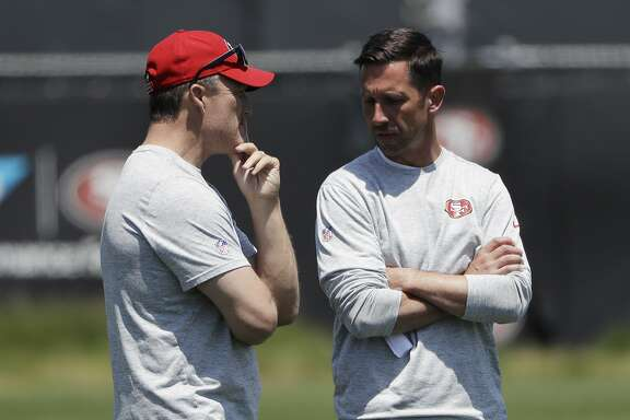San Francisco 49ers head coach Kyle Shanahan, right, talks to general manager John Lynch during the team's organized team activity at its NFL football training facility Tuesday, May 23, 2017, in Santa Clara, Calif. (AP Photo/Marcio Jose Sanchez)