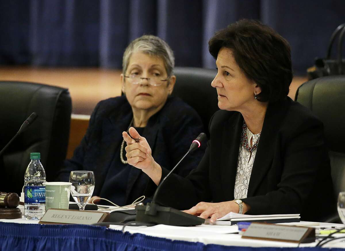 Regent Monica Lozano, right, questions state auditor Elaine Howle as University of California President Janet Napolitano, left, listens during a Board of Regents meeting Thursday, May 18, 2017, in San Francisco. The state auditor briefed the governing board Thursday on findings that UC administrators hid $175 million in a secret reserve fund even as the system raised tuition and sought more public funding. Howle says her office found murky budgeting practices in the office of UC President Janet Napolitano that failed to track expenditures and explain decision-making. (AP Photo/Eric Risberg)
