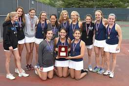The Darien girls tennis team celebrates its second straight FCIAC championship by posing for a trophy shot after defeating Staples 4-3 on Tuesday at Wilton High School.