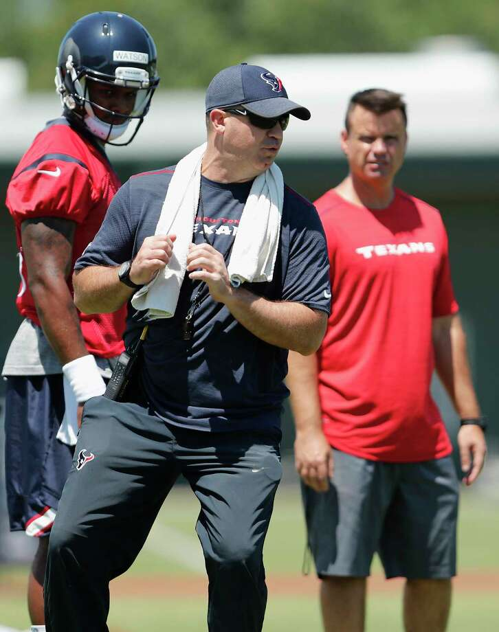 Houston Texans head coach Bill O'Brien demonstrates how to drop back to quarterback Deshaun Watson (4) during the Houston Texans OTAs at the Methodist Training Center in Houston, TX on Tuesday, May 23, 2017. Photo: Tim Warner, Freelance / Houston Chronicle