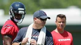 Houston Texans head coach Bill O'Brien demonstrates how to drop back to quarterback Deshaun Watson (4) during the Houston Texans OTAs at the Methodist Training Center in Houston, TX on Tuesday, May 23, 2017.