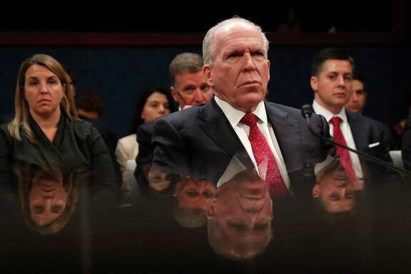 Former CIA Director John Brennan is reflected in a table as he prepares to testify on CapitolHill in Washington, Tuesday, May 23, 2017, before the House Intelligence Committee Russia Investigation Task Force. (AP Photo/Pablo Martinez Monsivais)