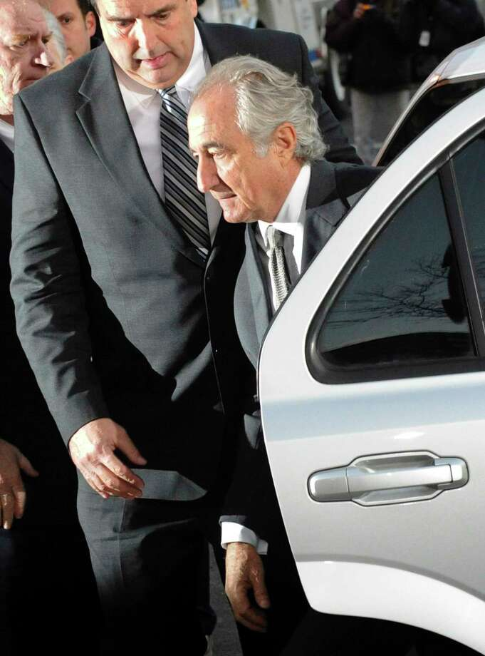Ponzi scheme leader Bernard Madoff arrives at Manhattan federal court in March 2009. He pleaded guilty that year to fraud and is serving a 150-year prison sentence.  Photo: Louis Lanzano, STF / AP