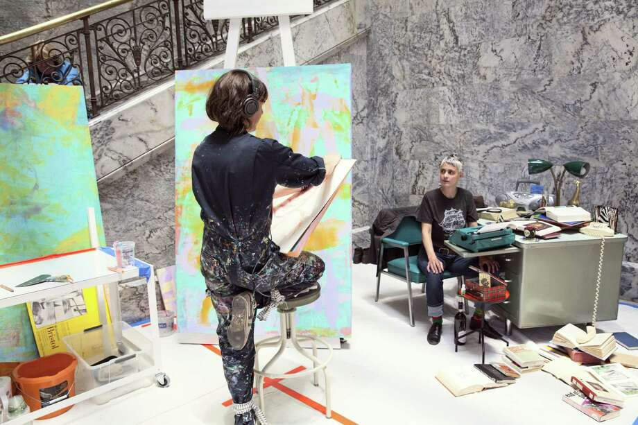Hope Gangloff at work on her portrait of Tammy Fortin at Cantor Arts Center