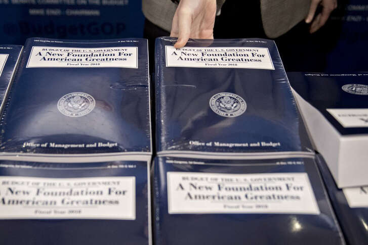 A copy of President Donald Trump's fiscal 2018 budget proposal. Funding for Medicaid would be cut by more than $800 billion over 10 years.  (Andrew Harrer / Bloomberg)