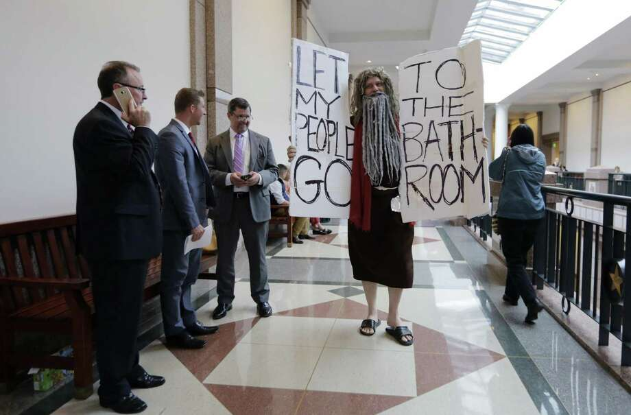 """John Erler protests as the Senate State Affairs Committee begin hearings about Senate Bill 6 at the Texas Capitol, Tuesday, March 7, 2017, in Austin, Texas. The the transgender """"bathroom bill"""" would require people to use public bathrooms and restrooms that correspond with the sex on their birth certificate. (AP Photo/Eric Gay) Photo: Eric Gay, STF / Associated Press / Copyright 2017 The Associated Press. All rights reserved."""