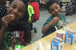 Children enjoy meals provided through the Kid's Cafe program. Crosby Branch Library has partnered with the Houston Food Bank to offer the Kid's Cafe program at their branch location, one of the summer food programs offered in the Lake Houston area this summer.