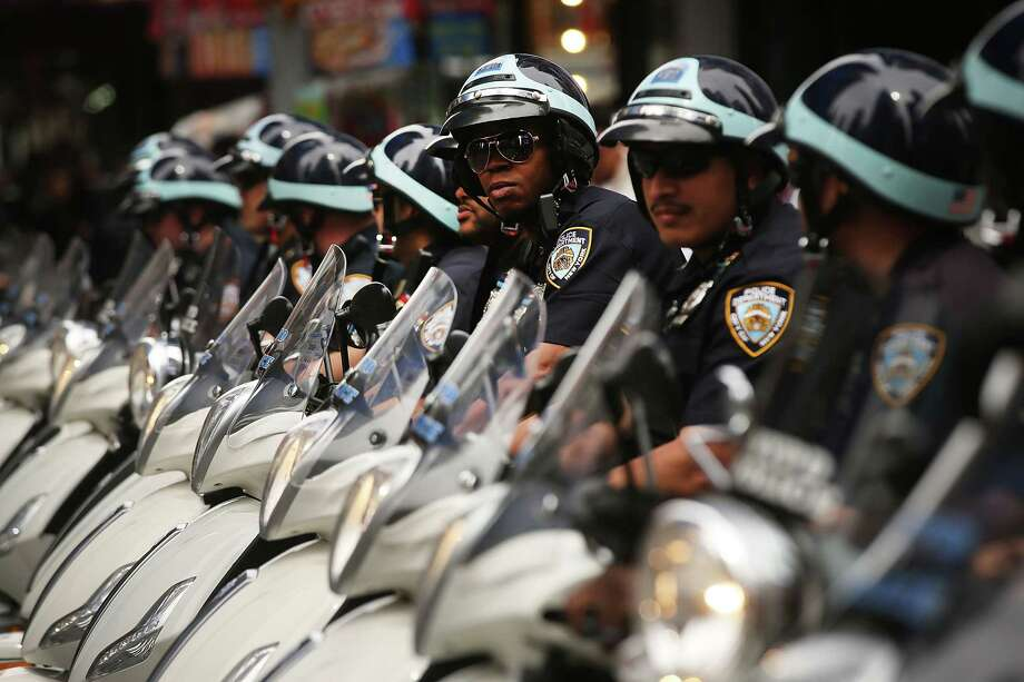 Police on scooters patrol in New York's Times Square the day after a terrorist attack in the English city of Manchester on May 23, 2017 in New York City. (Photo by Spencer Platt/Getty Images)  Photo: Spencer Platt / 2017 Getty Images