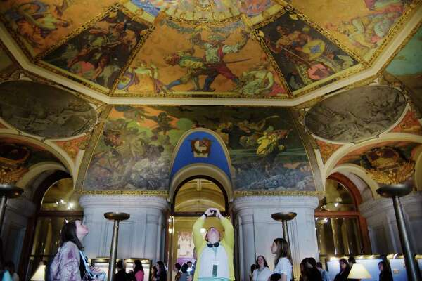 Members of 4H groups from around New York State look over the murals in the War Room during a tour of the State Capitol on Tuesday, May 23, 2017, in Albany, N.Y. (Paul Buckowski / Times Union)