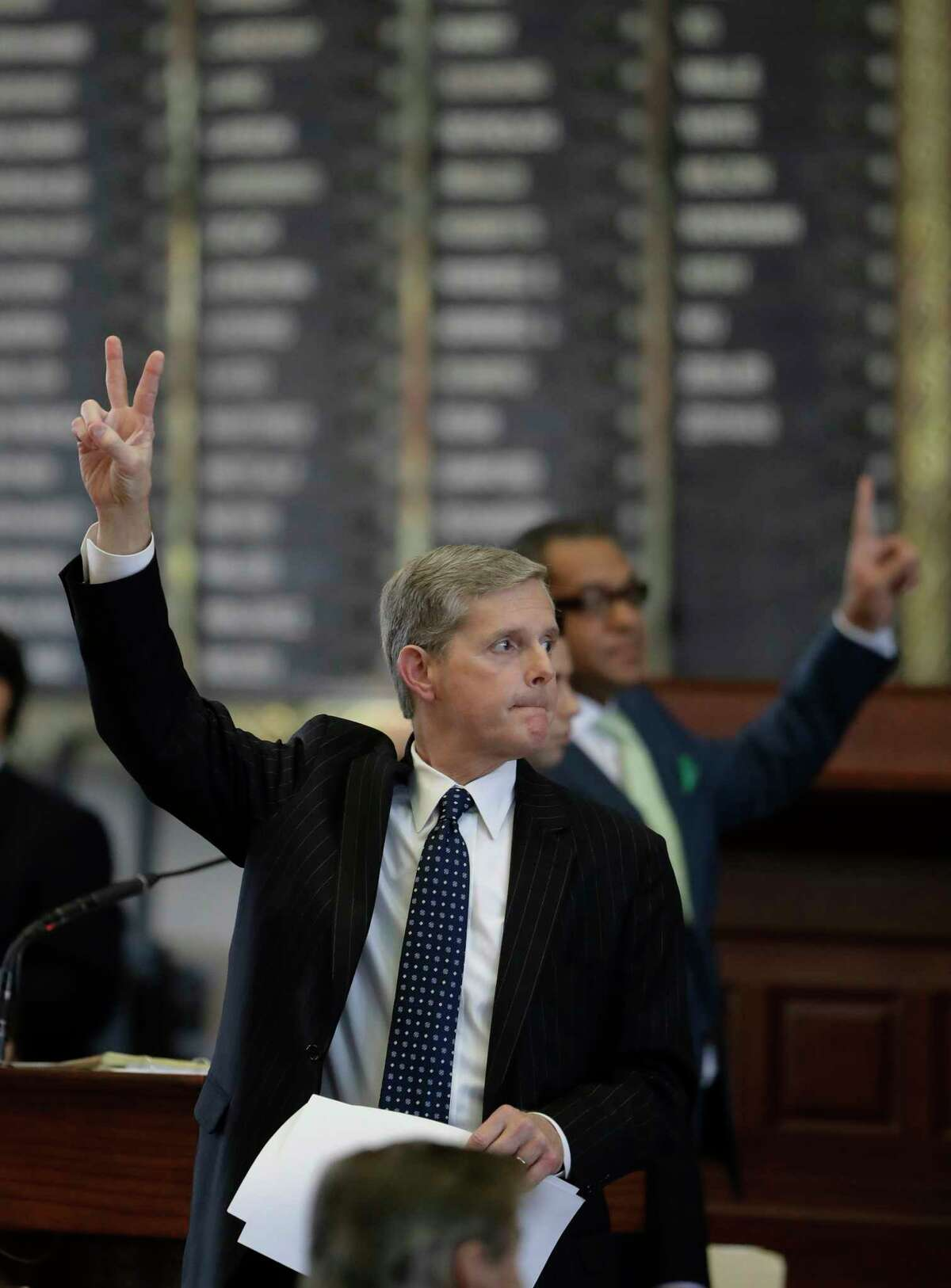 Texas Rep. Phil King, R-Weatherford, votes against an amendment to SB5, a weakened version of the state's voter ID law on Tuesday.