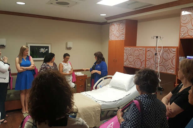 Katie Perez,International Board Certified Lactation Consultantat Kingwood Medical Center, highlights features of the labor and delivery rooms in the Women and Children's Center Monday, May 15.