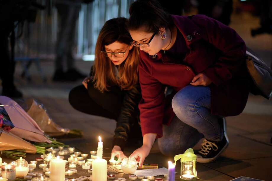 MANCHESTER, ENGLAND - MAY 23:  Members of the public attend a candlelit vigil, to honour the victims of Monday evening's terror attack, at Albert Square on May 23, 2017 in Manchester, England. Monday's explosion occurred at Manchester Arena as concert goers were leaving the venue after Ariana Grande had just finished performing. Greater Manchester Police are treating the explosion as a terrorist attack and have confirmed 22 fatalities and 59 injured.  (Photo by Jeff J Mitchell/Getty Images) Photo: Jeff J Mitchell, Staff / Getty Images / 2017 Getty Images