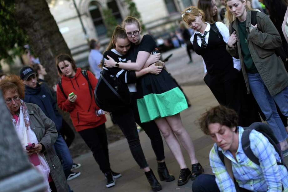 People attend a vigil in Albert Square in Manchester, England, on Tuesday, the day after the suicide bombing at an Ariana Grande concert that killed 22 people. It is the deadliest terrorist strike in Britain since 2005. Photo: Emilio Morenatti, STF / Copyright 2017 The Associated Press. All rights reserved.