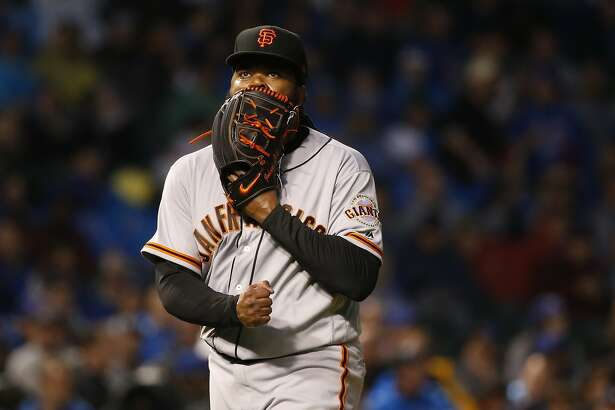San Francisco Giants starting pitcher Johnny Cueto yells into his glove after the fourth inning of a baseball game against the Chicago Cubs Tuesday, May 23, 2017, in Chicago. (AP Photo/Charles Rex Arbogast)