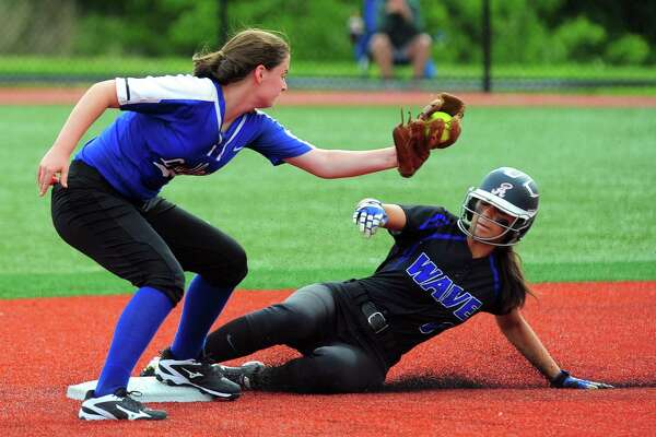 Darien's Kalani Caruso slides into second base as Fairfield Ludlowe's looks to tag her out during FCIAC softball semi-final action at Sacred Heart University in Fairfield, Conn., on Tuesday May 23, 2017. Caruso was called safe.