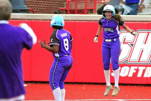 Westhill's Gabriella Laccona jumps up to celebrate after theVikings beat St. Joseph in 6-5 in eight innings.