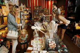 From left: Caroline Behler, her five-year-old daughter Stella Klein, Emily Busse and her boyfriend Sean Robinson check out the toys at Tantrum on Saturday, May 20, 2017, in San Francisco, Calif. The store is located at 858 Cole Street.