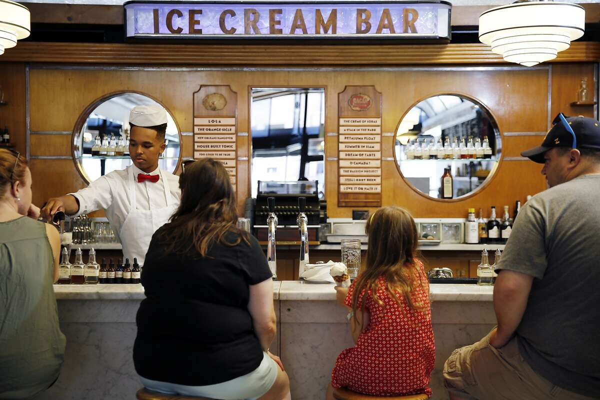 Soda jerk Jamal Hargrove helps customers at Ice Cream Bar on Saturday, May 20, 2017, in San Francisco, Calif. The store is located at 815 Cole Street.