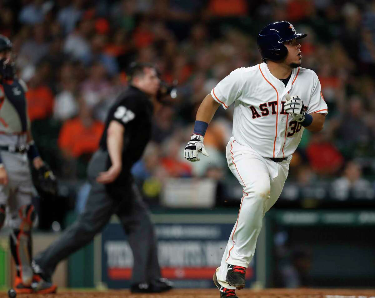 Houston Astros catcher Juan Centeno (30) watches his ball leave the park for a home run during the fourth inning of an MLB baseball game at Minute Maid Park, Tuesday, May 23, 2017.
