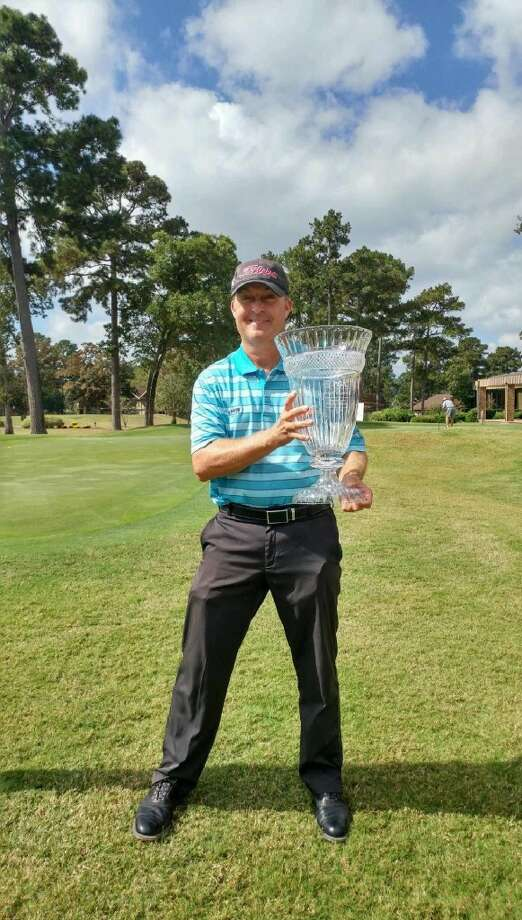 Stuart Hendley poses with a crystal trophy after winning a tournament last year. Courtesy photo