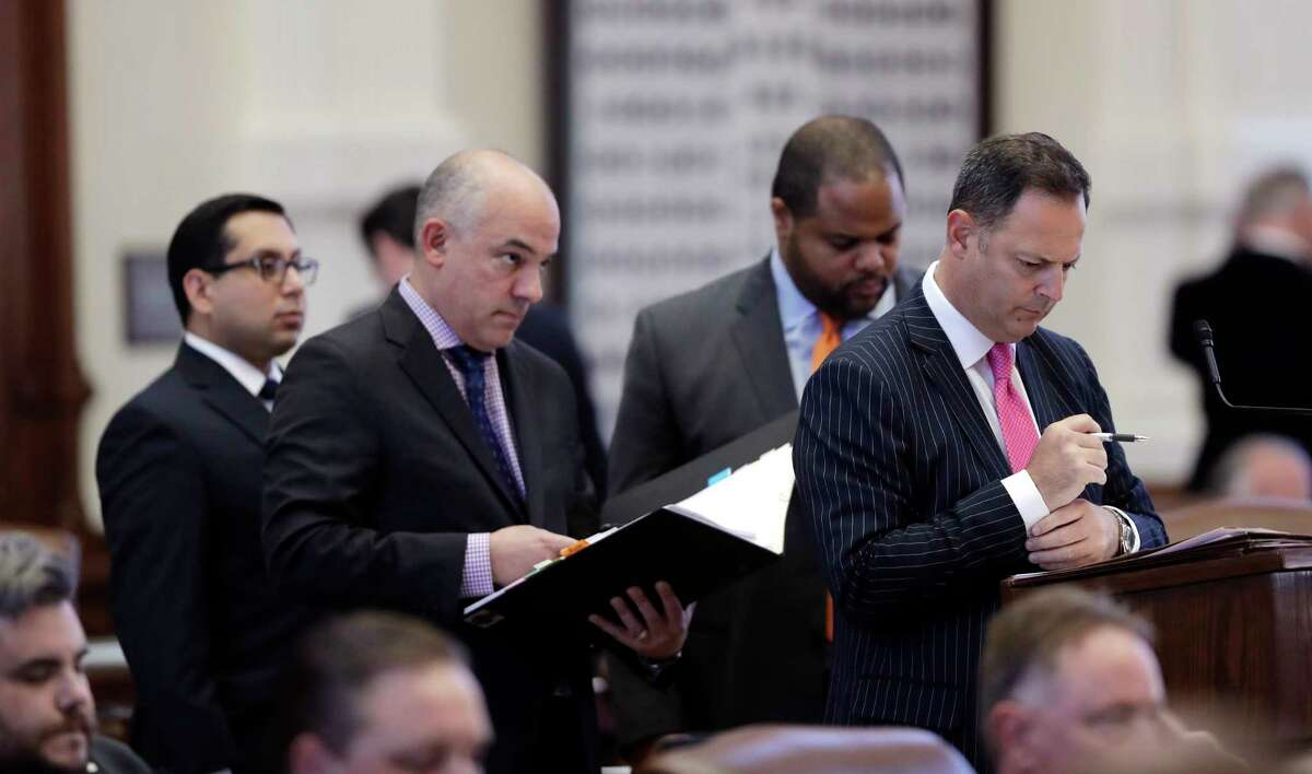 Texas Democratic lawmakers, from left, Rep. Diego Bernal, D-San Antonio, Rep. Chris Turner, D-Arlington, Rep. Eric Johnson, D-Dallas, and Rep. Rafael Anchia, D-Dallas, line up in the House Chamber to ask questions during debate over Senate Bill 5, a weakened version of the state's voter ID law that a federal judge called discriminatory.