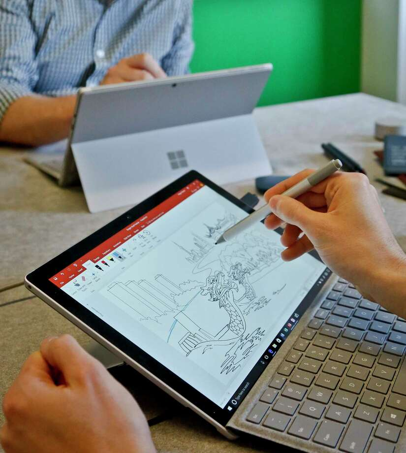 Microsoft's new Surface Pro laptop-tablet's stylus will now mimic pencil shading when tilted, much like the Apple Pencil for iPad Pro tablets.   Along with this, Microsoft plans upgrades to its popular Office software with new pencil-like features. (AP Photo/Bebeto Matthews) Photo: Bebeto Matthews, STF / Copyright 2017 The Associated Press. All rights reserved.