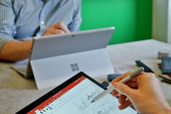 Microsoft's new Surface Pro laptop-tablet's stylus will now mimic pencil shading when tilted, much like the Apple Pencil for iPad Pro tablets.   Along with this, Microsoft plans upgrades to its popular Office software with new pencil-like features. (AP Photo/Bebeto Matthews)