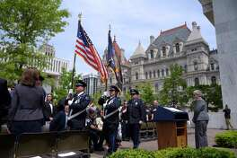 Members of the Northwell Health Center for EMS Honor Guard retire the colors at the end of a ceremony at the EMS Tree of Life Memorial at the Empire State Plaza on Tuesday, May 23, 2017, in Albany, N.Y.  The memorial honors emergency medical services providers who have passed away. (Paul Buckowski / Times Union)