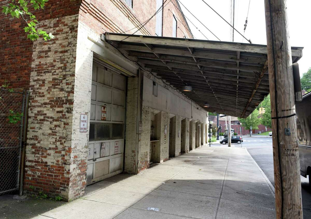 The Rep's future home, above, the former Gomez Electrical Contracting warehouse at 251 N. Pearl St., about four blocks north of its longtime home at 111 N. Pearl, dates to the 1860s, a renovation that is largely a restoration of the structure becomes eligible for historic tax credits.