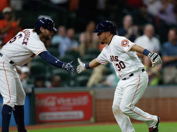 The Astros show off a bit of their depth as newly arrived catcher Juan Centeno (30) is greeted by Jake Marisnick after homering.