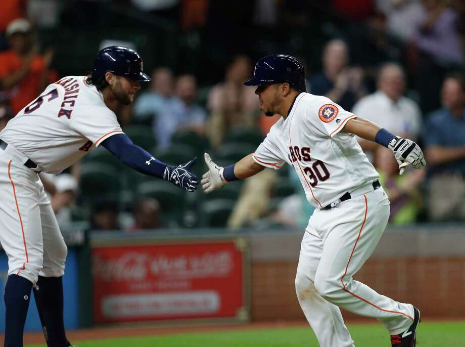 The Astros show off a bit of their depth as newly arrived catcher Juan Centeno (30) is greeted by Jake Marisnick after homering. Photo: Karen Warren, Staff Photographer / 2017 Houston Chronicle