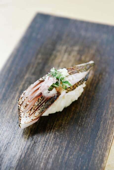At Ju-Ni in S.F.: Baby barracuda with fresh green onions, ginger and myoga. Photo: Michael Short, Special To The Chronicle