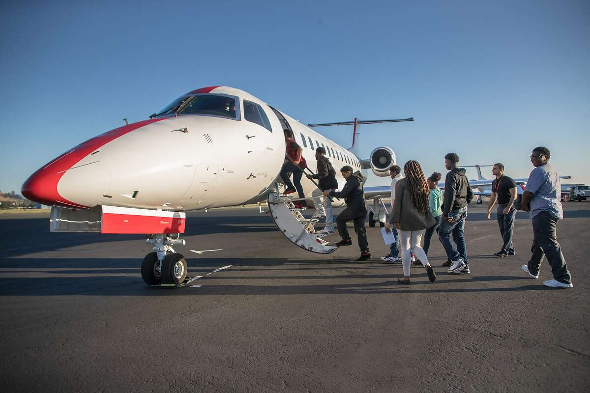 Richmond students board LA bound JetSuiteX's Embraer 135 on Tuesday, May 23, 2017 in Concord, Calif. The trip takes about 1 hour.